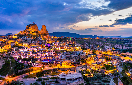 View of Uchisar with the castle at sunset. Cappadocia, Turkey